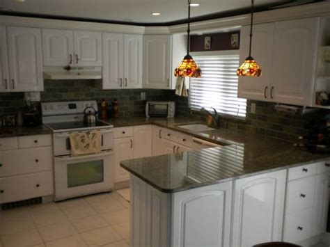 white kitchen cabinets with dark countertops white kitchen cabinets dark granite countertops my home