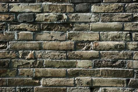 gamle mursten vaeggen som en flot baggrund eller tapet