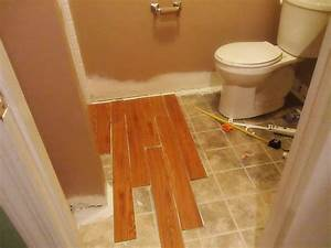 Installing vinyl wood plank flooring in small spaces for How to install linoleum floor in bathroom