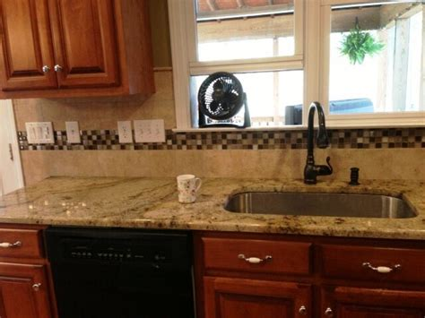 sienna beige granite  medium colored wood cabinets