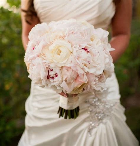 bridal bouquet of blush peonies and garden roses