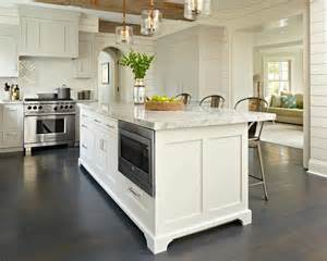 gray kitchen cabinets with white island and rope and