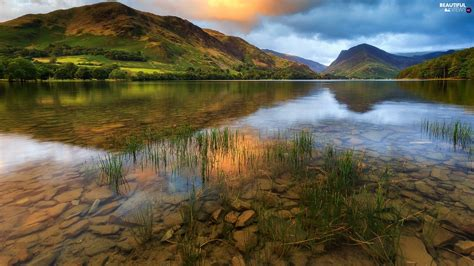 lake buttermere england stones grass mountains lake