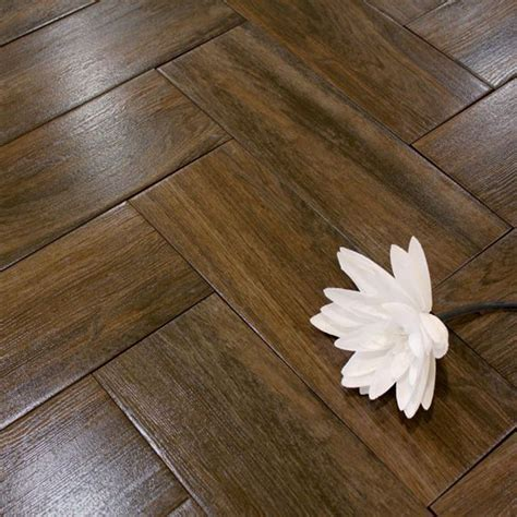 A dark brown wood effect ceramic tile with a very