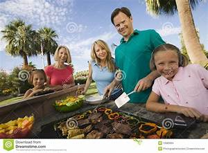 Family at outdoor barbecue stock photo. Image of cooking - 13583994
