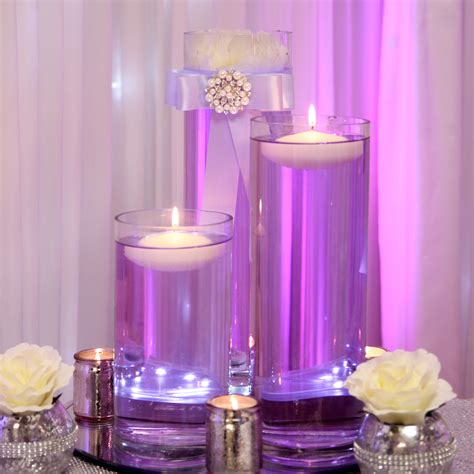 purple table runners floating candles beyond expectations weddings events