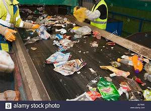 Rubbish on a conveyor belt for sorting at a recycling ...