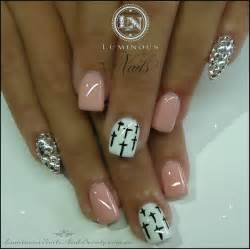 Nude pink nails with crystal pointy pinkie