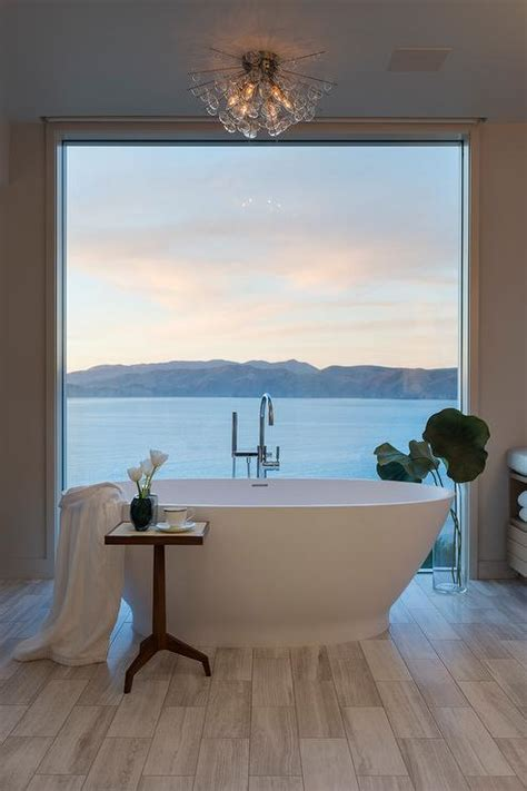 oval bathtub  front  floor  ceiling window