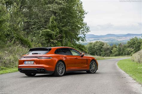 We're also huge fans of the executive models. 2021 Porsche Panamera Turbo S Sports Turismo - Papaya Metallic - Dailyrevs