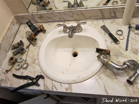replacing a kitchen faucet bathroom sink how to install a faucet