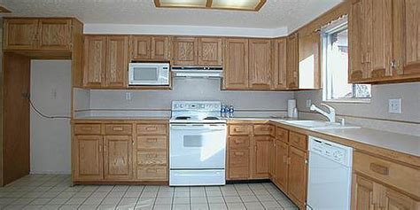 painted kitchen cabinets with white appliances painting kitchen cabinets before after 9053