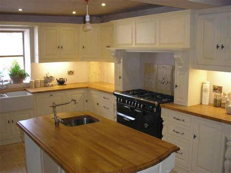 Cream Kitchens With Wood Worktops  Deductourcom. Designing Laundry Room. Loving Family Laundry Room. Great Room Suite Mandalay Bay. Secret Room Design. Cushioned Dining Room Chairs. Acrylic Dining Room Table. Gowning Room Design. Wood Room Dividers Partitions