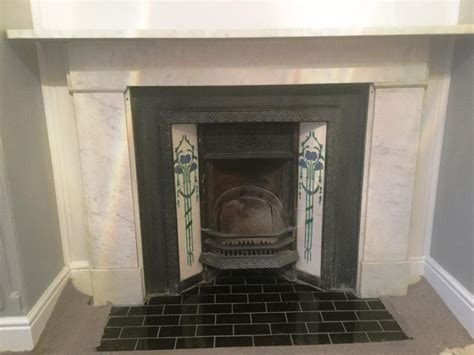 stained and discoloured marble fireplace rejuvenated in