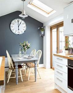 Tonal grey kitchen diner with painted farmhouse furniture for Kitchen colors with white cabinets with art clocks wall