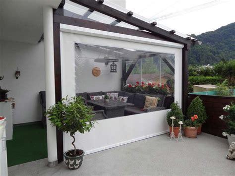glasschiebewand für terrasse als windschutz durchsichtiges folienrollo f 252 r terrassen als ma 223 anfertigung