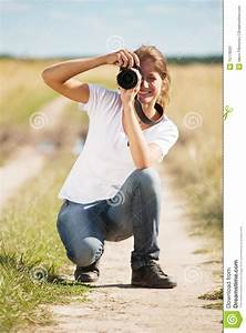 Girl Taking Photo With Camera Stock Image