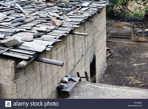 concrete building with slat roof held in place by rocks yongzhi royalty free