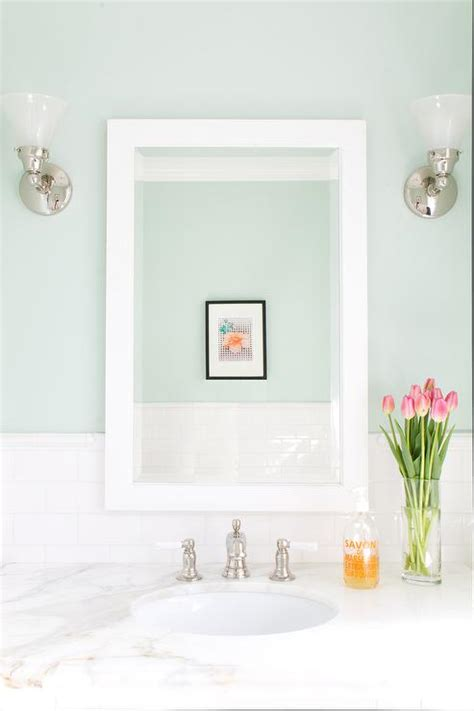 Mint Green Bathroom Walls With White Subway Tiles. Corner Benches. Rustic Metal Mirror. Loft Home. Screened Porches