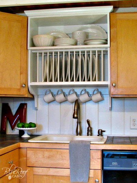 remodelaholic diy wall mounted pot rack   shallow display cabinet