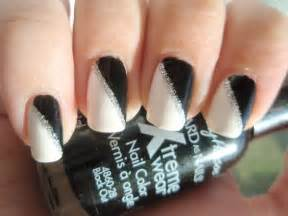 White nail polish with designs and black