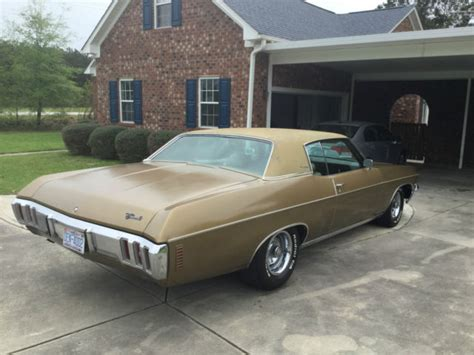 seller  classic cars  chevrolet impala goldgold