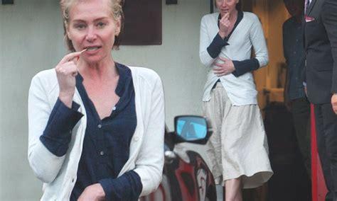 A slender Portia De Rossi goes makeup free with wife Ellen