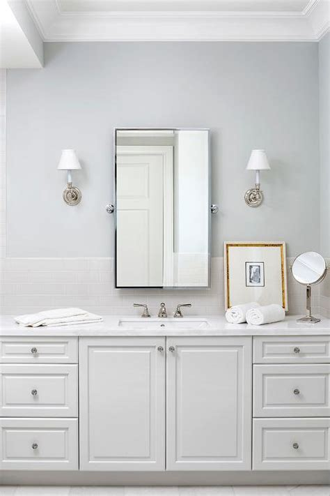 light gray subway tiles  white bath vanity