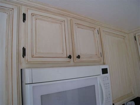 antique white cabinets with chocolate glazing kitchen