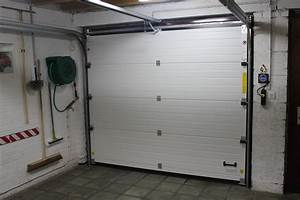 Placement de porte de garage sectionnelle et basculante for Porte de garage enroulable de plus porte interieur