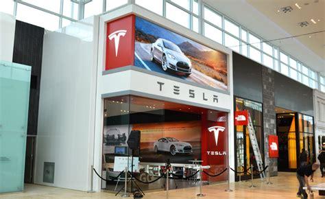tesla flagship store opens  canada autoguidecom news