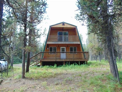 property image cute modified  frame cabin surrounded  national forest  frame cabin