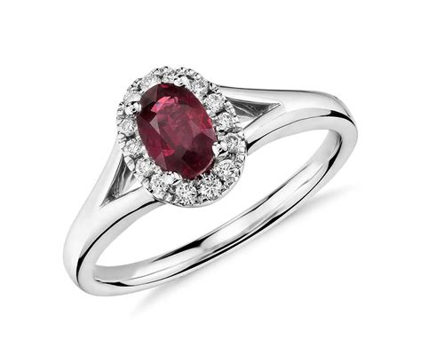 oval ruby and halo ring in 18k white gold tanary