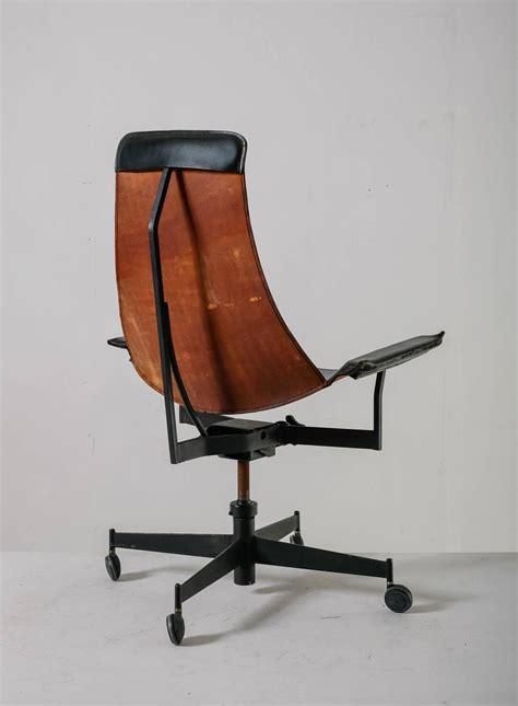 william katavolos swiveling black leather sling chair usa