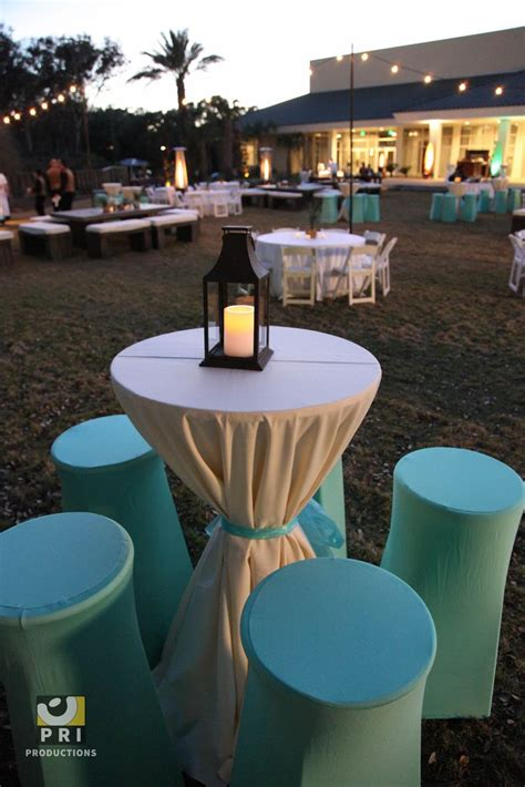 A solid blue ottoman is a perfect place to keep an inviting coffee table book. aqua spandex bar stool covers.   Tablescapes & Settings   Pinterest   Bar stool covers, Aqua and ...