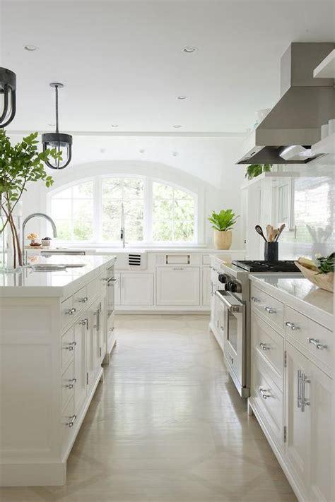 arched kitchen windows  sink transitional kitchen