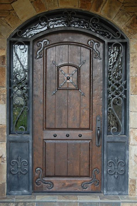 love  large oversized front door    mix  wood iron  windows doors