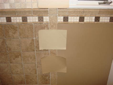can i paint kitchen tiles 17 best ideas about brown tile bathrooms on 8045