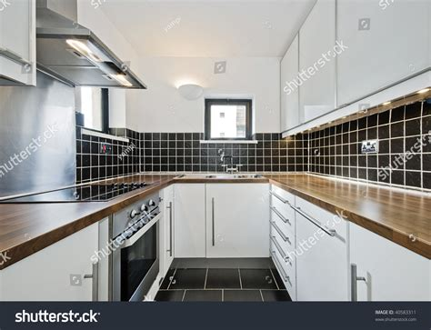 kitchen with black tiles modern kitchen black ceramic tiles wooden stock photo 6496