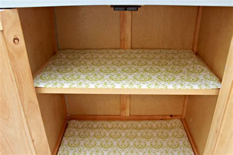 paper to line cabinets organizing in the kitchen with duck brand shelf liner