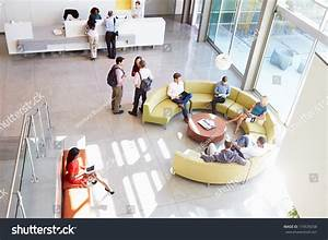 Reception Area Of Modern Office Building With People Stock ...