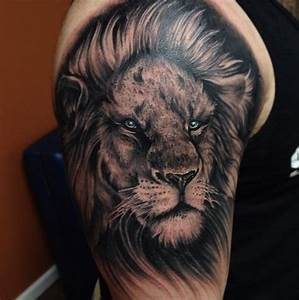 Blue eyes black lion tattoo - TattooMagz