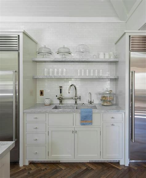 Stacked Marble Floating Shelves Over Kitchen Sink