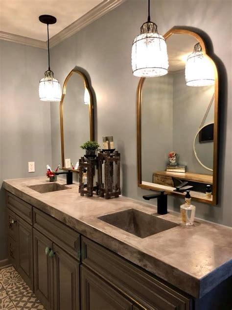gold mirrors  bathroom  gray concrete bathroom