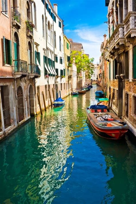 Blue And Green Water Of A Venetian Canal Italy Stock