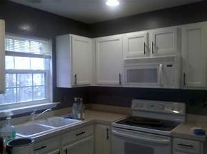 dark gray kitchen walls with white cabinets during With kitchen cabinets lowes with black and gray wall art