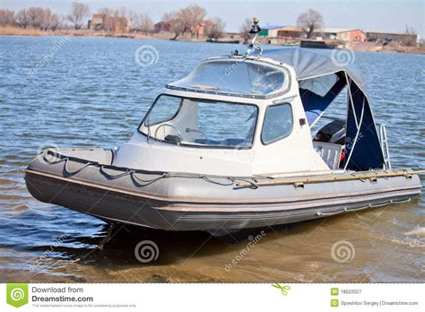 Small Motor Boat Licence by Boat With A Cabin Royalty Free Stock