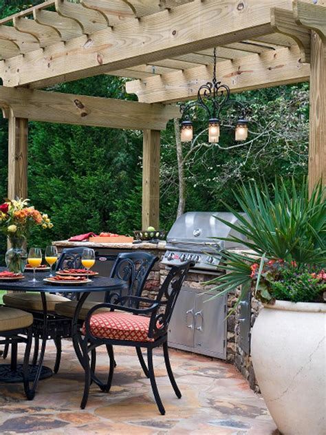 outdoor kitchen  dining area  rustic wood pergola