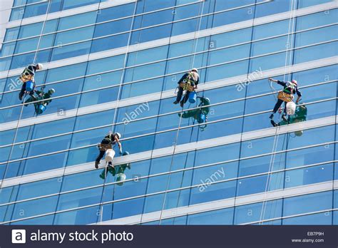 bosuns chair window cleaning window cleaners cleaning windows of modern office tower