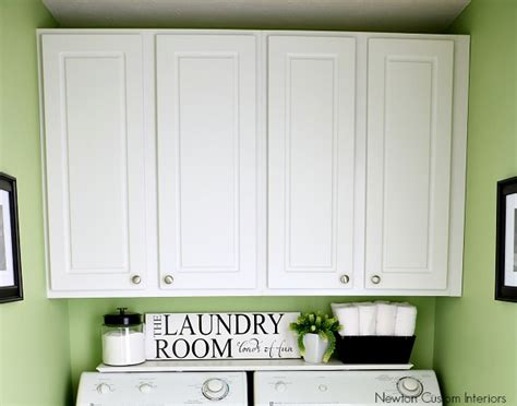 small laundry room storage cabinets organizing a small laundry room newton custom interiors